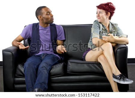 multi-racial male and female roommates sharing a couch