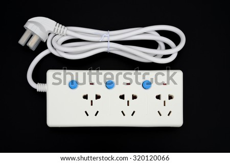 multi sockets power extension with individual switiches on black - stock photo