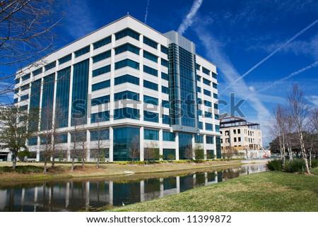 multi-story modern office building along the Riverwalk in Jacksonville, Florida - stock photo