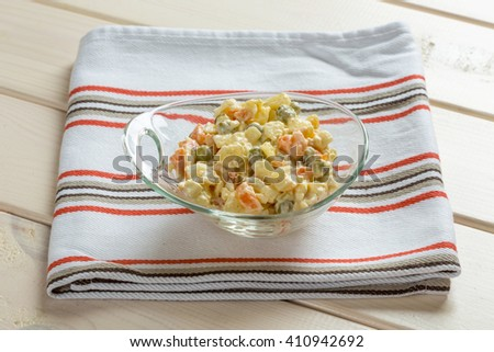 Multi vegetable salad in glass bowl on textile - stock photo