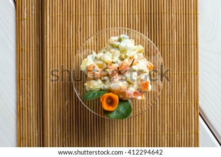 Multi vegetable salad in glass bowl on wooden sticks - stock photo