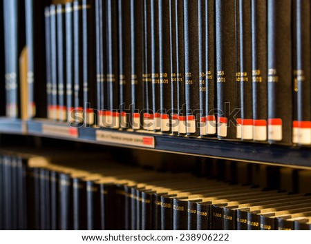 Multi-volume book collection in the library - stock photo
