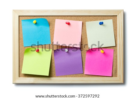 Multicolor blank post it notes on a cork notice board - stock photo