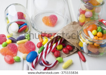 Multicolor candies in glass jars  - stock photo