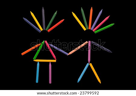 Multicolor crayons sorted in shapes of male and female on black background - stock photo