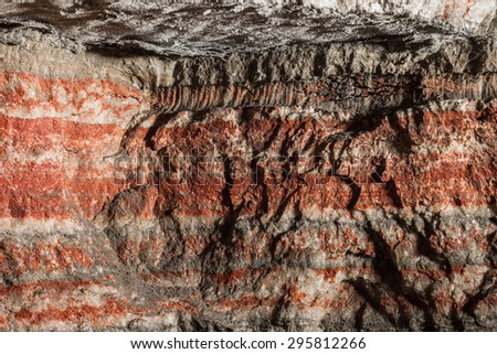 multicolor fragment of potassium salt mine's wall - stock photo