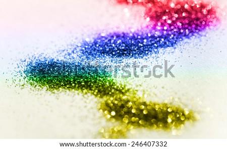 Multicolor glitter on light background - macro photo - stock photo