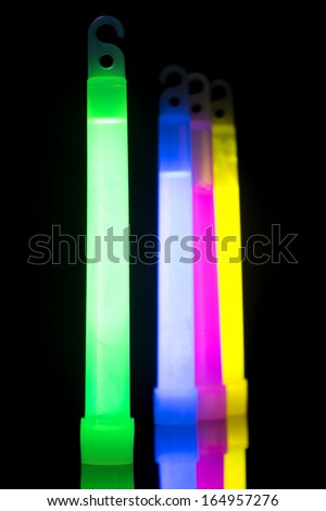 Multicolor glow sticks, with selective focus