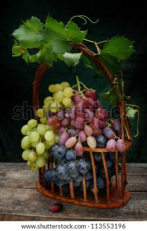 multicolor grape clusters at basket