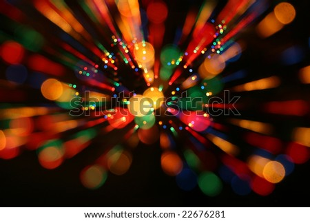 Multicolor  lights (out of focus) with zooming. It's a natural zoom effect, NOT a photoshop filter. - stock photo