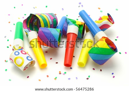 Multicolor party blowers on white background - stock photo