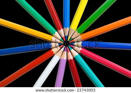 Multicolor pencils on a black background. - stock photo