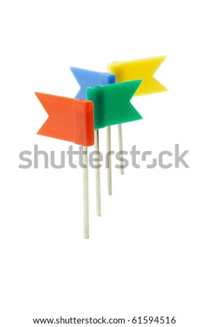 Multicolor plastic flag pins in a row on white background
