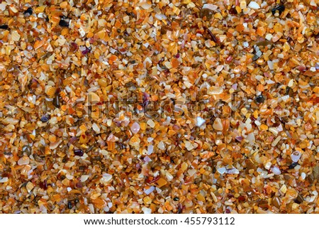 Multicolor sand on beach in sun summer day. View from above. Nature background. - stock photo
