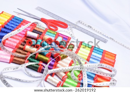 Multicolor sewing threads on background, color full  - stock photo