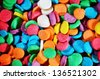 Multicolor sugar sprinkles macro background photo - stock photo