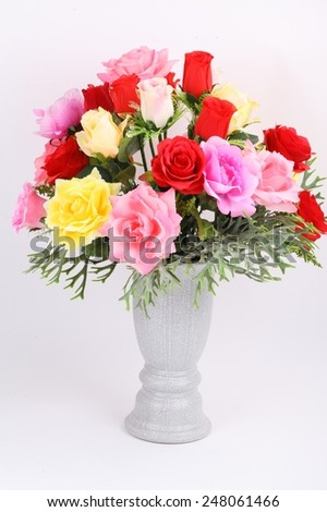 Multicolored arrangement of flowers in vase isolated on a white background - stock photo
