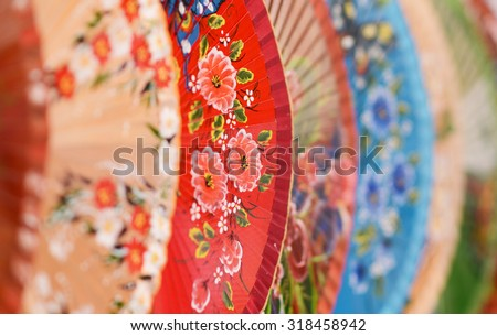 Multicolored Asian fans abstract view - stock photo