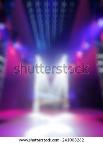 Multicolored background disco. Blurred background nightclub spotlight on disco. Disco lights in the shape of a star. Blur background in the form of stars - stock photo