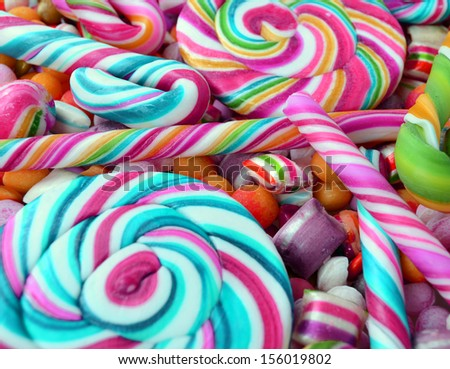 Multicolored background made of various colorful candies - stock photo