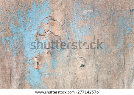 Multicolored background: wooden surface with blue paint flaking and cracking texture - stock photo