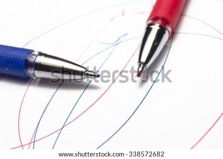 Multicolored ball pens on white background