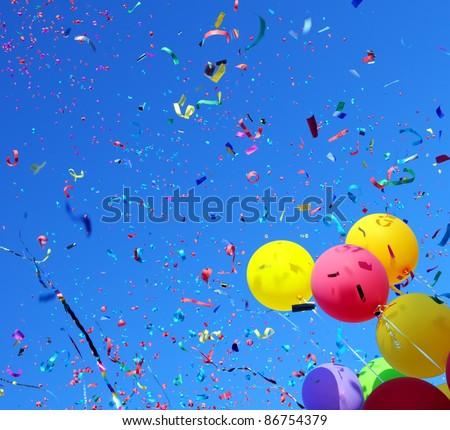 multicolored balloons and confetti in the city festival #2 - stock photo