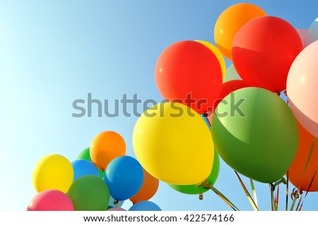 multicolored balloons in the city festival - stock photo