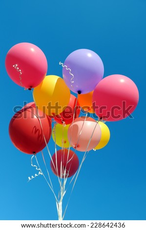 multicolored balloons in the city festival, vertical composition - stock photo