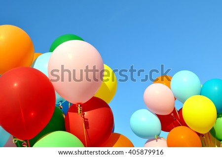 multicolored balloons  on blue sky background