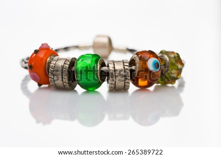 multicolored beads bracelet isolated  - stock photo