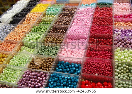 Multicolored beads in a in bijouterie shop for handmade accessories