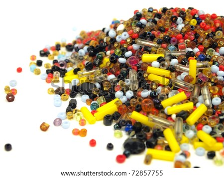 Multicolored beads on a white background - stock photo