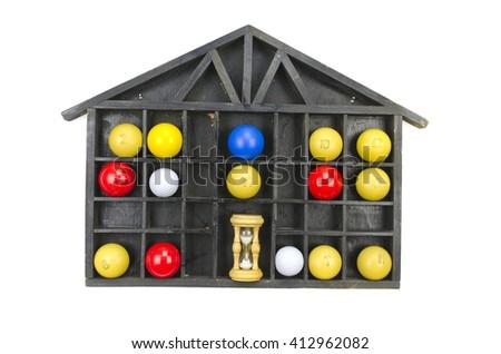 Multicolored billiard balls and sand clock in black wooden shelf - stock photo