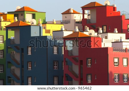 Multicolored buildings in Praya de las Americas Tenerife Canary Islands - stock photo