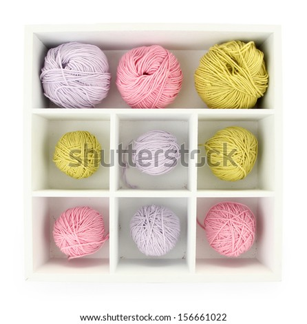 Multicolored clews in wooden box isolated on white - stock photo