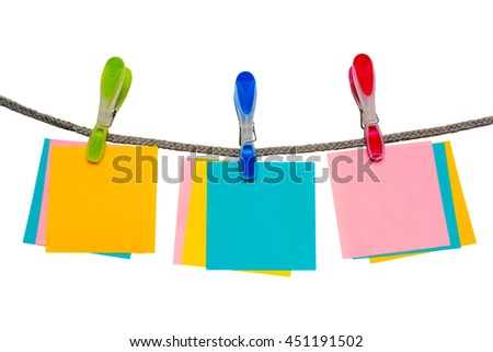 Multicolored clothespins with blank paper. - stock photo
