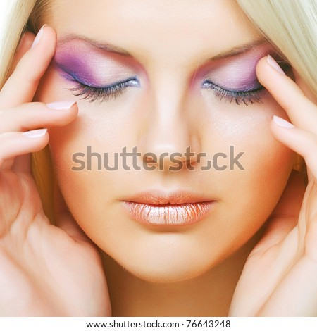 Multicolored creativity make-up. Close-up portrait of young beautiful woman.
