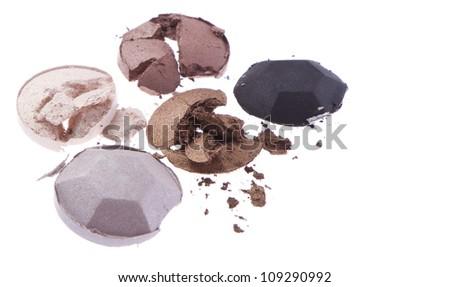 multicolored crushed eyeshadows isolated on white background - stock photo