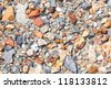 Multicolored crushed stone in bright sunlight day - stock photo
