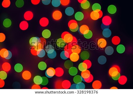 Multicolored defocused bokeh blurry lights, Christmas lights, festive background - stock photo