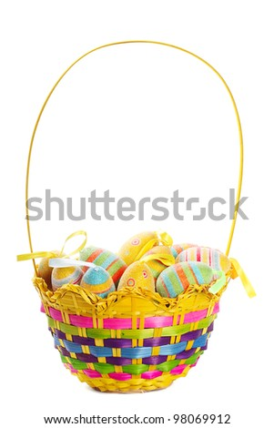 Multicolored Easter eggs in wicker basket isolated on white background - stock photo