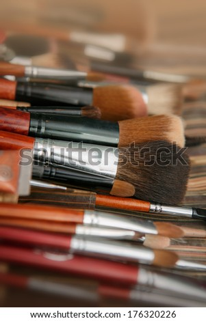multicolored eye shadows with cosmetics brush - stock photo