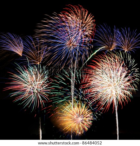 Multicolored fireworks fill the square frame - stock photo
