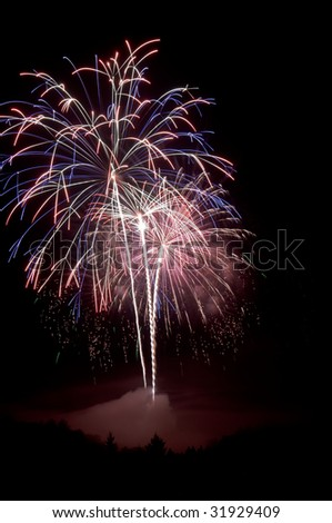 Multicolored fireworks on 4th of July, Independence Day in the United States of America - stock photo