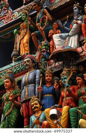 Multicolored hinduism statues on the roof of the Sri Mariamman Hindu temple, Singapore - stock photo