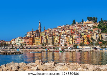 Multicolored houses of Old City overlooking shoreline of Mediterranean sea on French Riviera in town of Menton. - stock photo