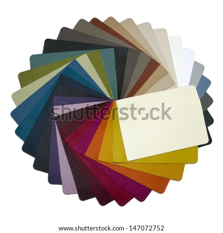multicolored leather samples arranged in a circle - on a neutral background - stock photo
