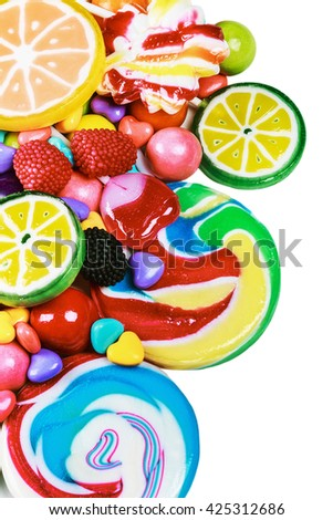 multicolored lollipops, candy and chewing gum on a white background