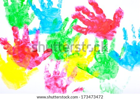 Multicolored painted hand prints on a white background (red, yellow, blue and red colors) - stock photo